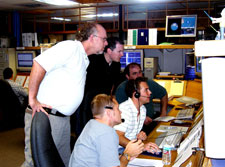 The GP-B Mission Operations team communicates with a NASA ground tracking station following helium depletion in the dewar.