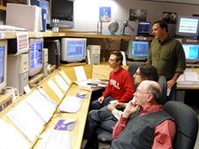 GP-B team members monitor the progress ofinstrument calibration procedures.