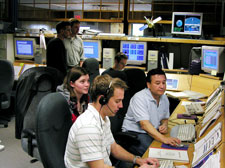Members of the GP-B Mission Operations team upload commands to the spacecraft following the re-boot of a computer on-board the spacecraft.