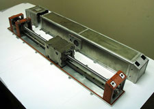 A Mass Trim Mechanism (MTM), consisting of a moveable weight, mounted on a long screw shaft that is turned by a motor.